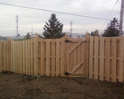 Cedar semi-private shadow box fence with concave scallop top